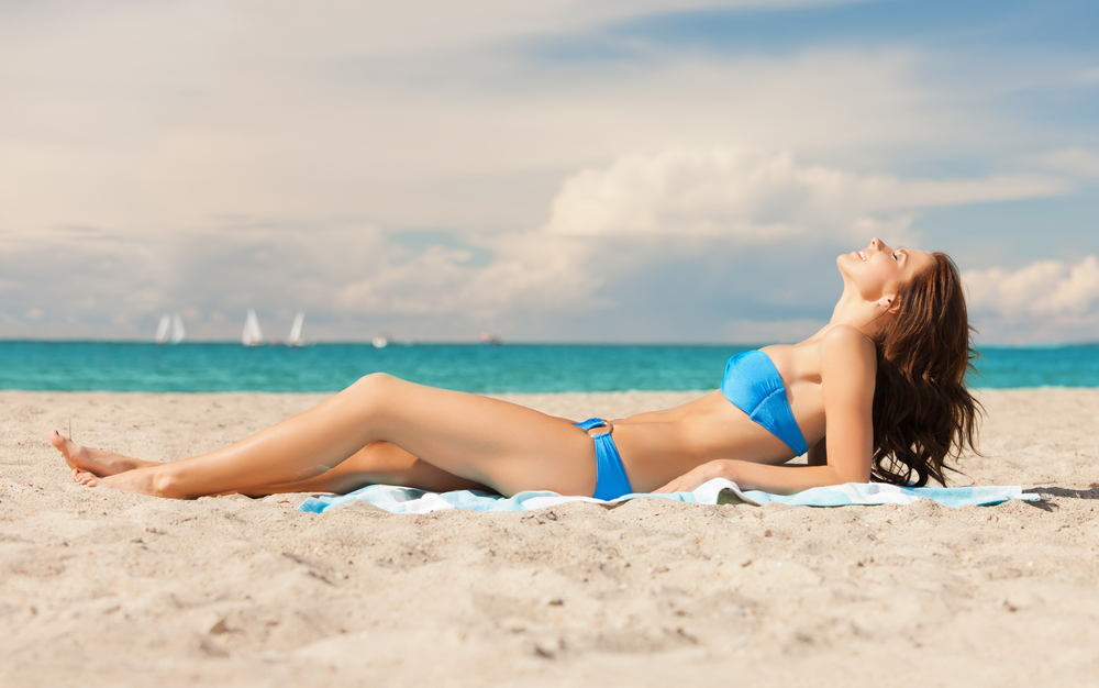 Young woman lying on the  barbados beach