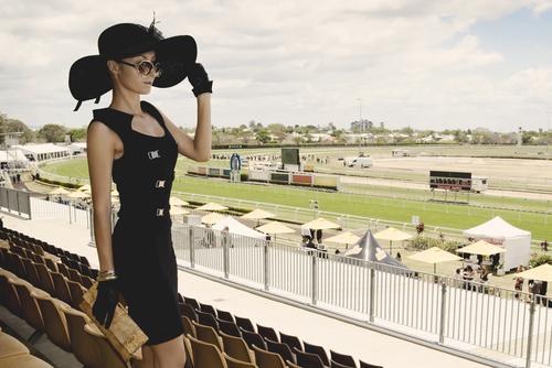 lady dressedfor derby horse race
